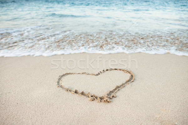 Heart shape drawn in sand Stock photo © AndreyPopov