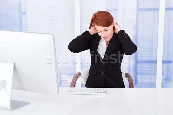 Işkadını boyun ağrısı bilgisayar büro genç çalışma Stok fotoğraf © AndreyPopov
