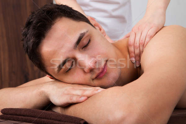 Man schouder massage spa portret jonge man Stockfoto © AndreyPopov
