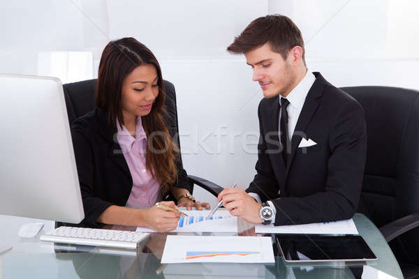 Business People Analyzing Graph Stock photo © AndreyPopov