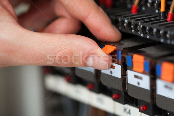 Electrician Turning On Switch In Fusebox Stock photo © AndreyPopov