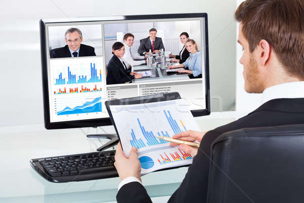 Stock photo: Businessman Video Conferencing With Colleagues