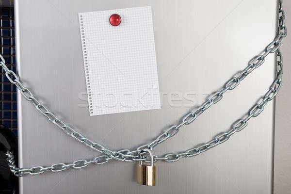 Blank Note Of Locked Fridge Stock photo © AndreyPopov