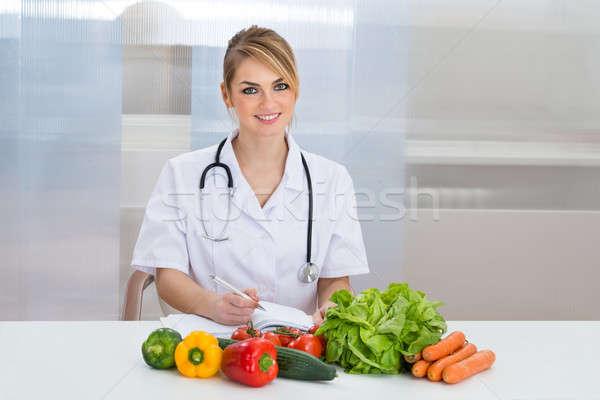 Portrait Of Happy Female Dietician Stock photo © AndreyPopov