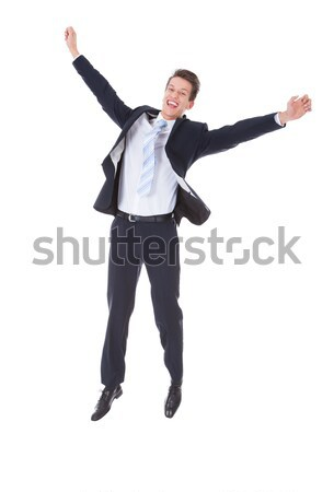 Successful Businessman Jumping With Hands Raised Stock photo © AndreyPopov