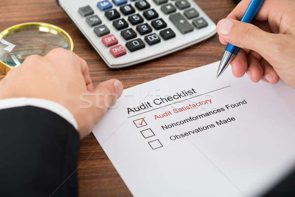 Person Filling Audit Checklist Form Stock photo © AndreyPopov
