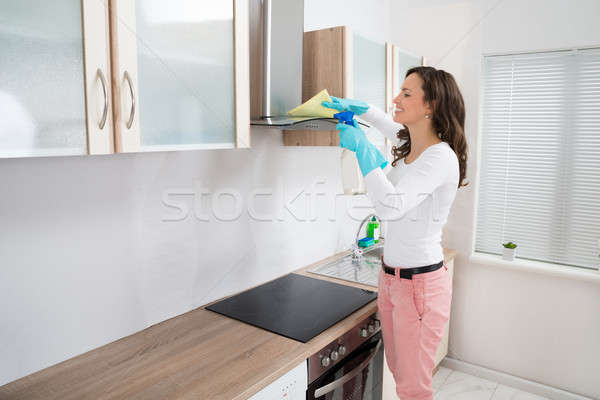 Woman Cleaning Cooker Hood Stock photo © AndreyPopov