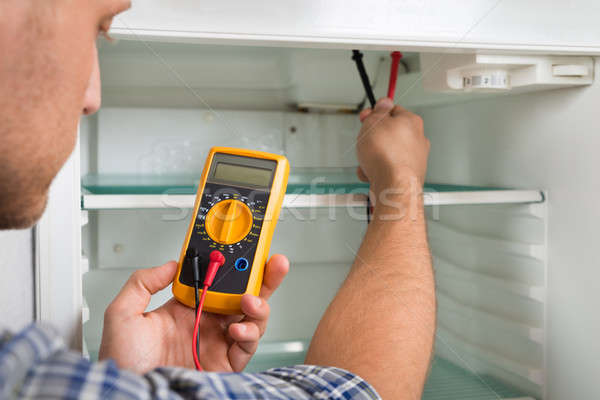 Technician Checking Fridge With Multimeter Stock photo © AndreyPopov