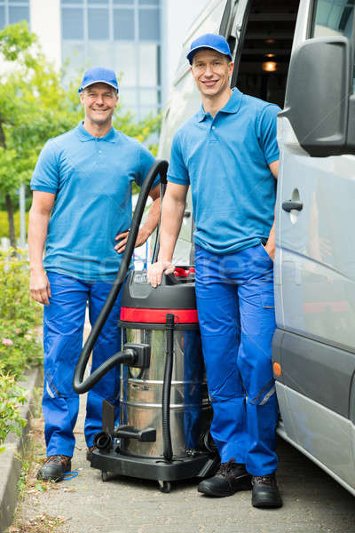 Two Male Cleaners With Vacuum Cleaner Stock photo © AndreyPopov