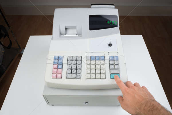 Person Hands On Cash Register Stock photo © AndreyPopov