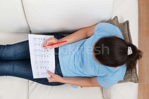 Woman Marking Date On Calendar Stock photo © AndreyPopov