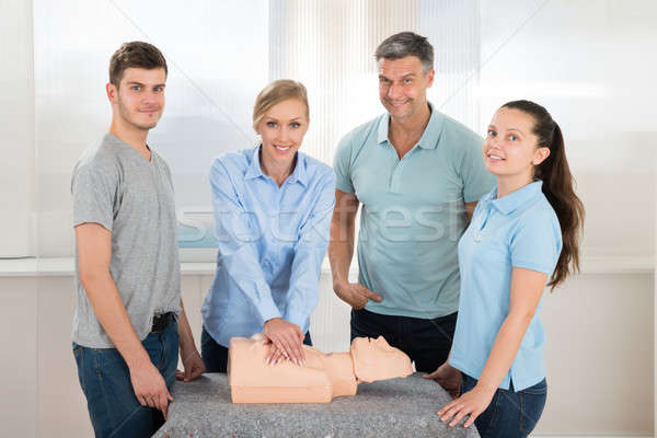 Students Practicing Cardiopulmonary Resuscitation Stock photo © AndreyPopov