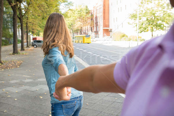 Woman Holding Hands Of Man Stock photo © AndreyPopov