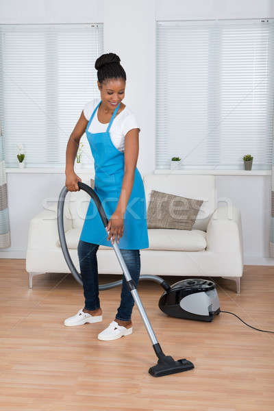 Woman Cleaning Floor With Vacuum Cleaner Stock photo © AndreyPopov