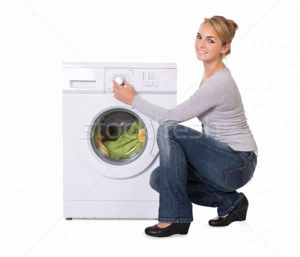 Woman Crouching While Using Washing Machine Stock photo © AndreyPopov