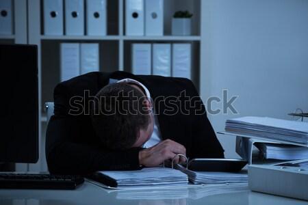 бизнесмен голову столе рабочих поздно Сток-фото © AndreyPopov