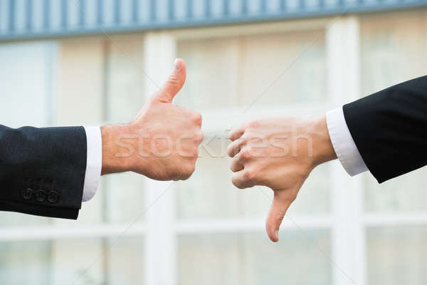 Businessmen Showing Like And Dislike Signs Stock photo © AndreyPopov