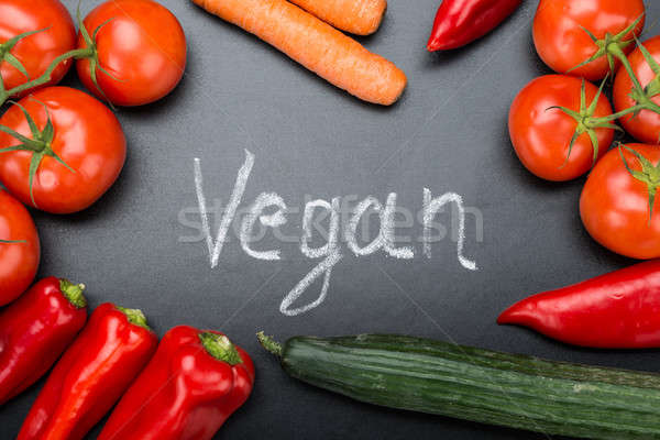 Vegan Written Amidst Fresh Vegetables On Blackboard Stock photo © AndreyPopov