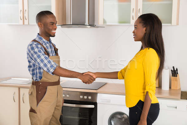 Serviceman And Woman Handshaking Stock photo © AndreyPopov