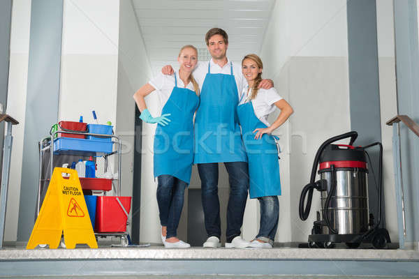 Portrait Of Janitors Holding Cleaning Equipments Stock photo © AndreyPopov