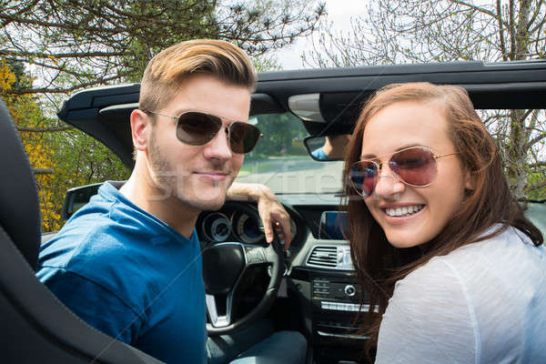 Happy Couple Sitting In A Car Stock photo © AndreyPopov