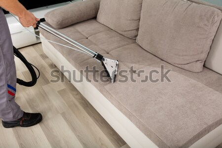 Személy takarítás kanapé porszívó magasról fotózva kilátás Stock fotó © AndreyPopov