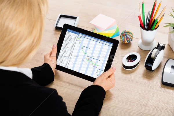 Businesswoman Working On Gantt Chart On Digital Tablet Stock photo © AndreyPopov