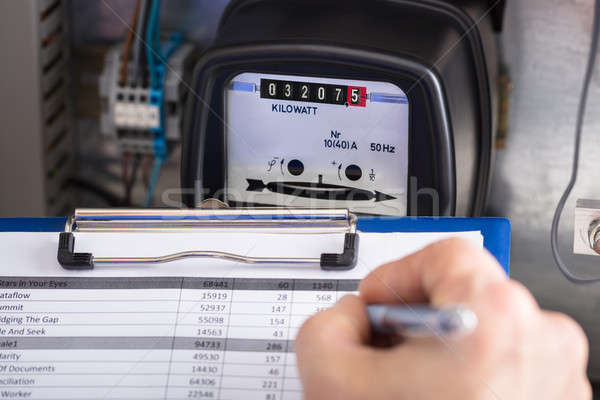 Technician Writing Reading Of Meter On Clipboard Stock photo © AndreyPopov