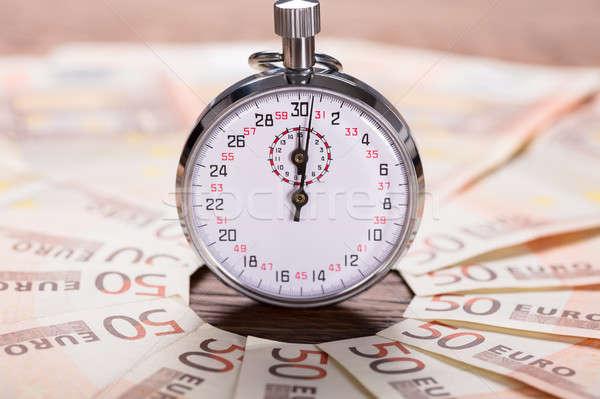 Stopperóra bankjegy közelkép Euro idő pénzügy Stock fotó © AndreyPopov