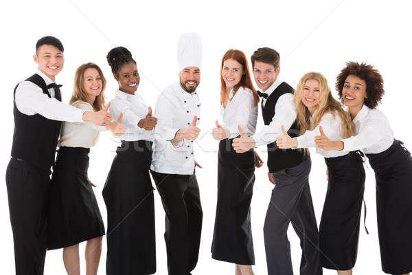 Glimlachend restaurant personeel witte Stockfoto © AndreyPopov
