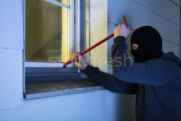 Burglar Using Crowbar To Break Into A House Stock photo © AndreyPopov