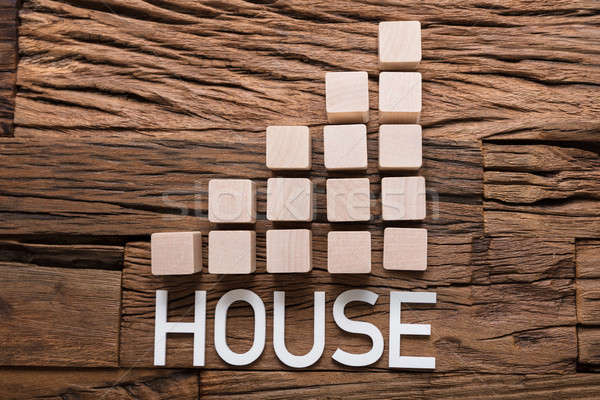 House Text By Increasing Bar Graph Blocks On Wood Stock photo © AndreyPopov