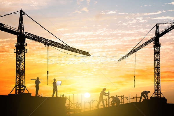 Engineers Working At Construction Site Stock photo © AndreyPopov