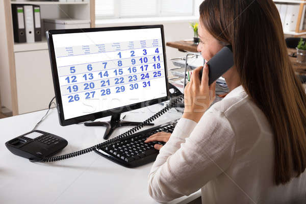 Close-up Of A Young Businesswoman Talking On Landline Phone Stock photo © AndreyPopov