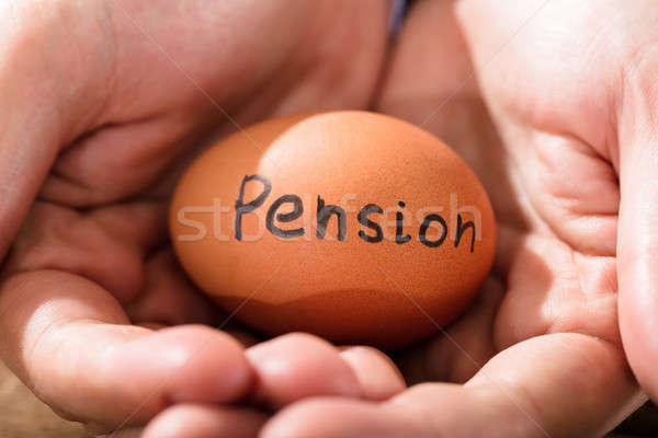 Main humaine oeuf pension texte Photo stock © AndreyPopov