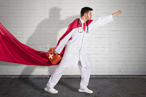Superhero Doctor Carrying First Aid Box Stock photo © AndreyPopov