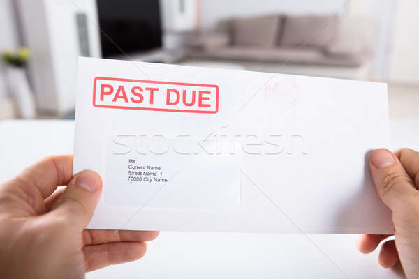 Person Holding Past Due Bill Envelope Stock photo © AndreyPopov