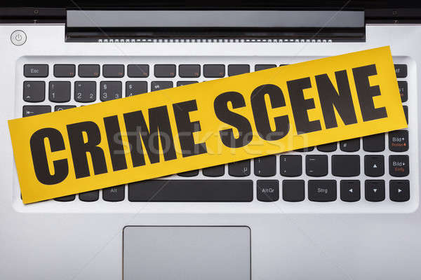 Miejsce zbrodni taśmy laptop widoku Zdjęcia stock © AndreyPopov