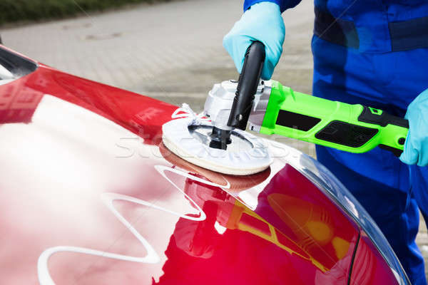 Person's Hand Polishing Car Hood Stock photo © AndreyPopov