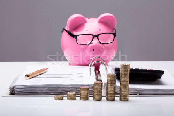 Egymásra pakolva érmék irat persely közelkép asztal Stock fotó © AndreyPopov