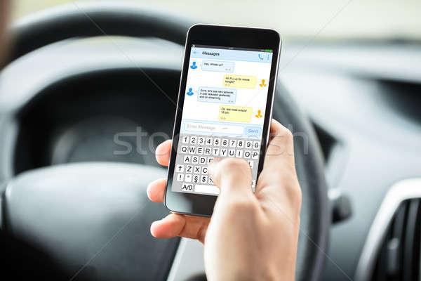 Személyek kéz sms üzenetküldés közelkép bent autó Stock fotó © AndreyPopov