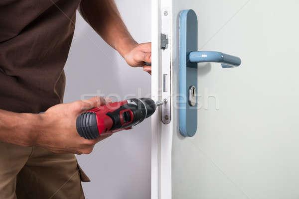 Carpenter Installing Door Lock Stock photo © AndreyPopov