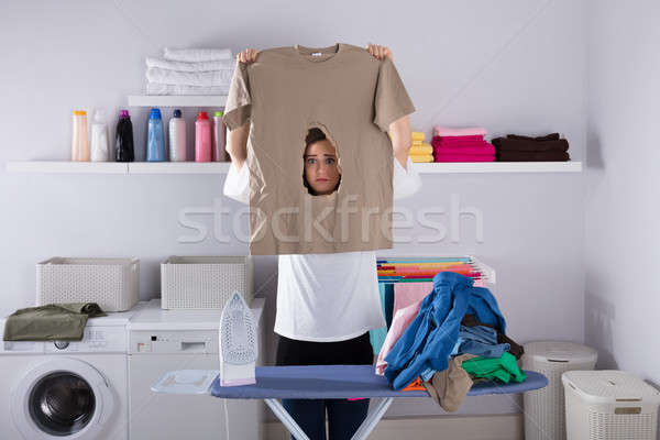 Woman Looking At Burned Cloth Stock photo © AndreyPopov