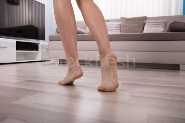 Low Section View Of An Foot On Warm Floor Stock photo © AndreyPopov