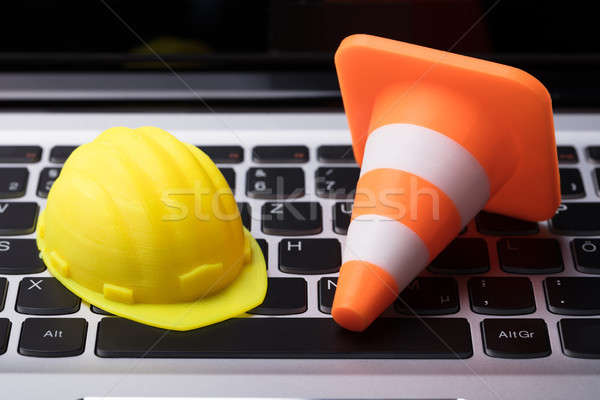Close-up Of Hard Hat And Traffic Cone Stock photo © AndreyPopov
