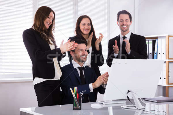 Young Businesspeople Clapping Their Hands Stock photo © AndreyPopov