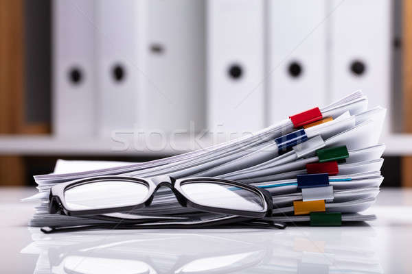 Stacked Documents And Eyeglasses Stock photo © AndreyPopov