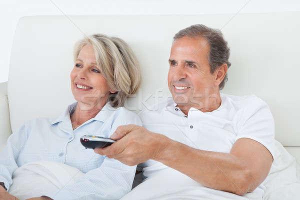 Boldog pár tv nézés idős pár ágy család Stock fotó © AndreyPopov