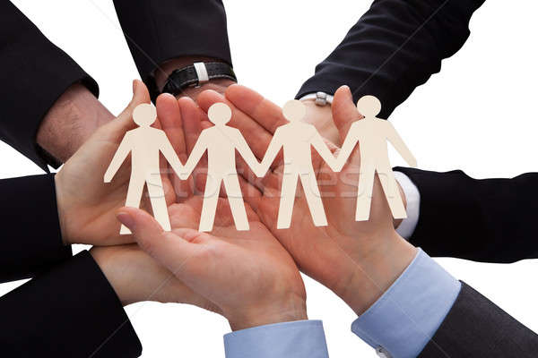 Businesspeople Holding Human Figure Cutout Stock photo © AndreyPopov