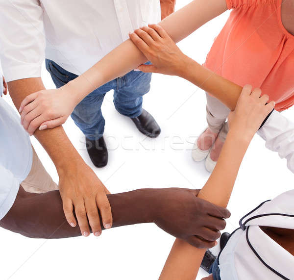 Multi-racial Hands Holding Each Other Stock photo © AndreyPopov